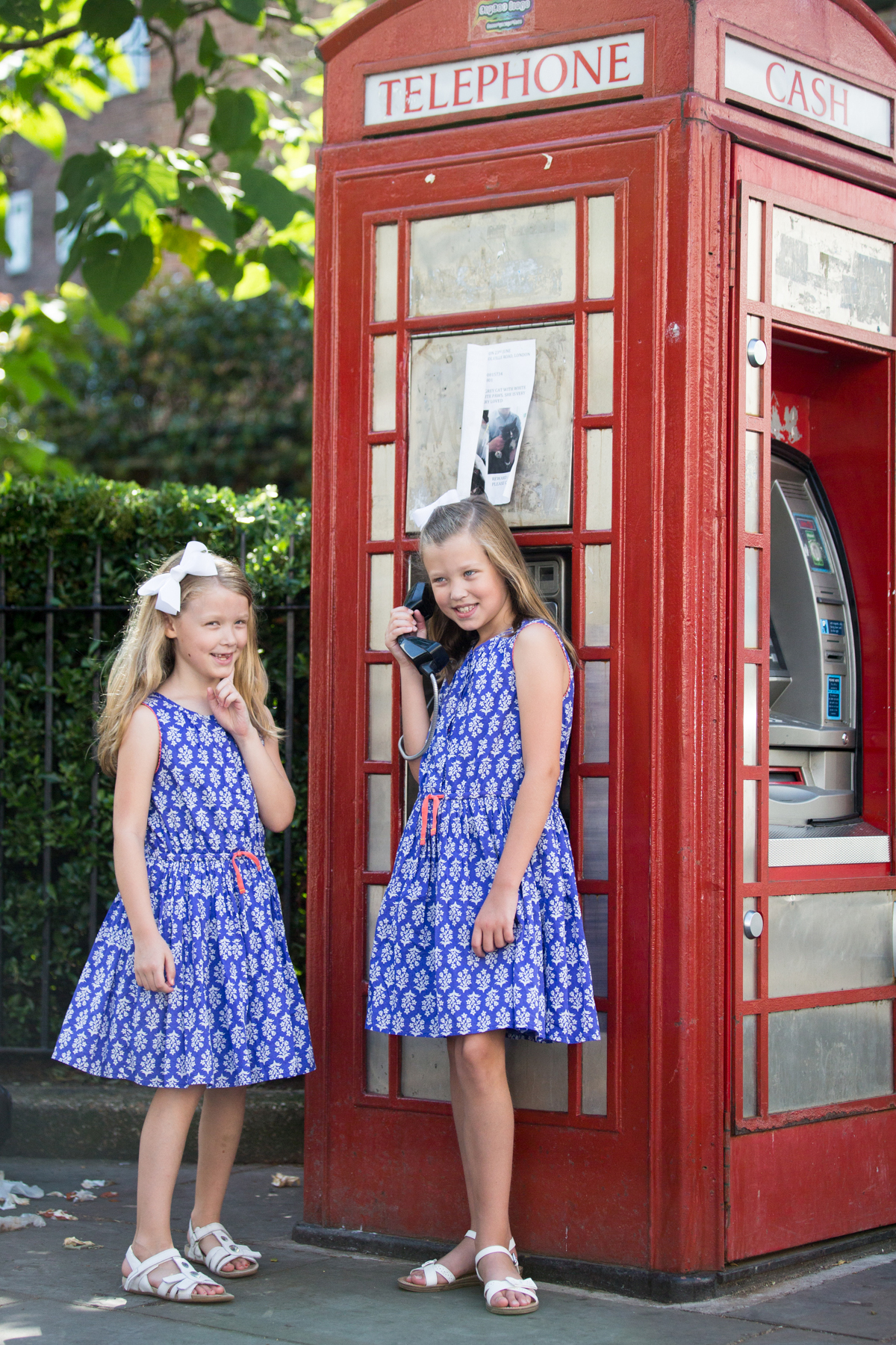childs portrait, Notting Hill, Red phone box, London photo portrait