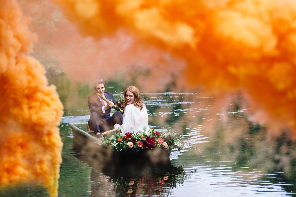 smoke bomb outdoor wedding by a lake
